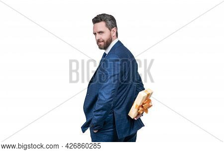 Confident Businessman Man In Suit Hiding Gift Box Behing Isolated On White, Make Surprise