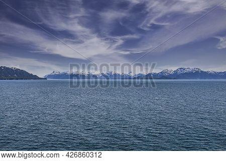 Inside Passage Waterway And The Alaskan Mountain Range On The Horizon