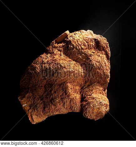 Brown Aragonite Mineral From Ural, Russia Isolated On Black Background. For Geology Mineralogy Magaz