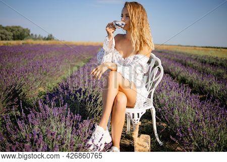 Pretty Blonde Woman Drinking Tea In Lavender Field.