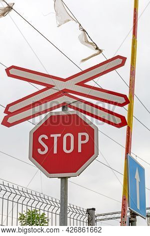 Stop Sign At Multi Rails Crossing Intersection