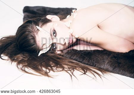 Halloween Fictional Creature Make Up Long Hair. Magical Horror Female Creature Lay Light Background.