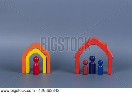 Divorce, Conflict Between Parents, Children Custody, Property Division. Wooden Houses, Miniature Fig