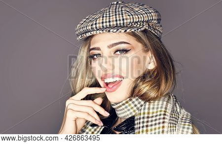 Sexy Lady In Fashionable Outfit, Close Up. Girl With Long Hair Wears Plaid Kepi, Scarf, Grey Backgro