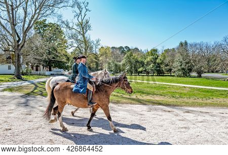 Williamsburg, Virginia, USA: 31st March 2021; Two men on horses in historical colonial Williamsburg