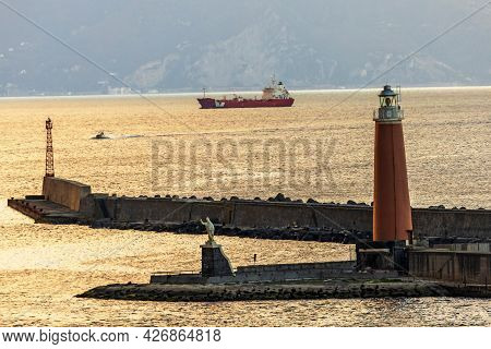 Port Of Naples,italy.early Morning View Of The Lighthouse On The Island Of St. Vincenzo,mentioned In