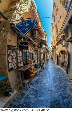 Rethymno, Crete Island, Greece - June 20, 2021: Small Souvenir Shops And Taverns Located On The Pict