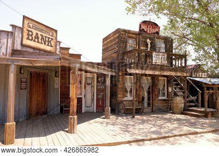 July 14, 2021 In Pioneertown, Ca:  Vintage Rustic Wooden Buildings On A Boardwalk Taken In Pioneerto