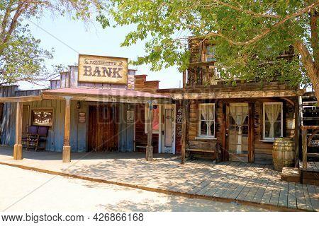 July 14, 2021 In Pioneertown, Ca:  Vintage Wooden Buildings On A Rustic Boardwalk Besides Cottonwood
