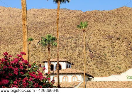July 14, 2021 In Palm Springs, Ca:  Hisorical Spanish Colonial Revival Building Surrounded By Palm T