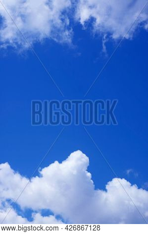 Vibrant Blue Sunny Sky Between The Pure White Clouds