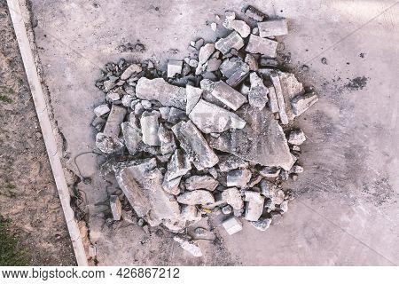 Concrete And Brick Rubble Debris On Construction Site Top View.