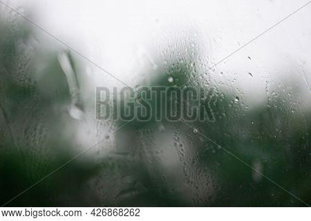 Raindrops On Window , Rainy Day. Background Raindrops. Blurred Background