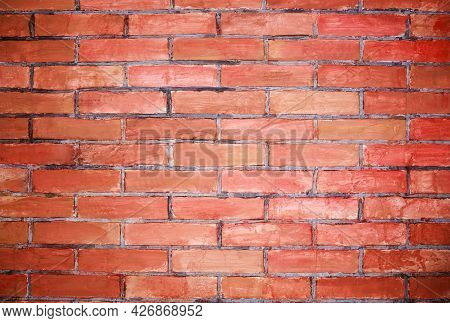 Brick Screen Saver. Empty Brick Wall. Red Grunge Brick In The Wall With Gray Putty. Hand Made Brick