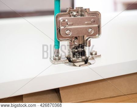 Furniture Assembly Concept, Furniture Assembly With A Screwdriver