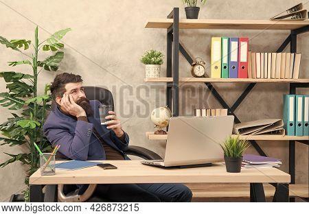 Bearded Man In Business Wear Enjoy Drinking Cup Of Tea Or Coffee At Office Desk, Pleasure