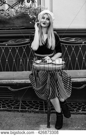 Funky Beauty. Parisian Woman Wear French Beret. Pretty Girl Relax In Cafe. Morning Coffee For Breakf