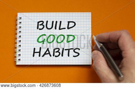 Build Good Habits Symbol. Businessman Writing Words 'build Good Habits' On White Note. Beautiful Ora