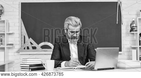 Digital Technology. Teacher At Classroom. Watch Video For Step By Step Tutorial. Handsome Man Use Mo