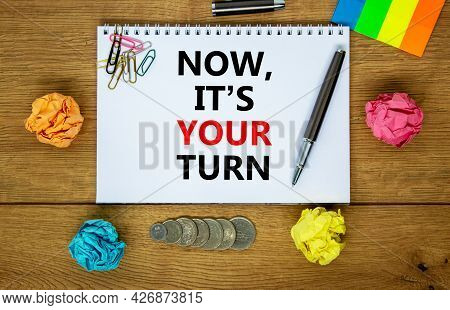Now It Is Your Turn Symbol. Words 'now It Is Your Turn' On White Note. Wooden Table, Colored Paper,