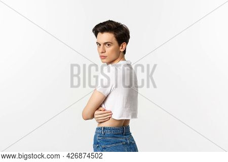 Lgbtq And Pride Concept. Profile View Of Beautiful Gay Man In Crop Top Turn Head At Camera, Staring