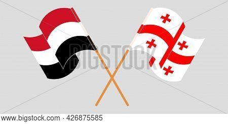 Crossed And Waving Flags Of Georgia And Yemen