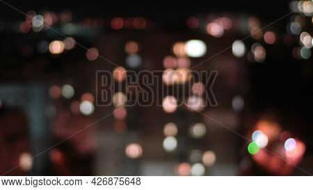 Defocused Circles Of Bokeh Lights In Night City. Cinematic Aesthetic Night Background In Shades Of D