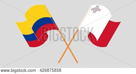 Crossed And Waving Flags Of Malta And Colombia