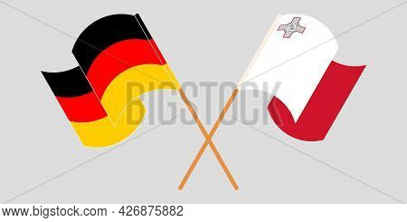 Crossed And Waving Flags Of Malta And Germany