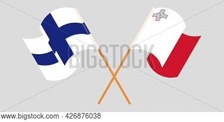 Crossed And Waving Flags Of Malta And Finland
