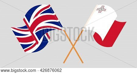 Crossed And Waving Flags Of Malta And The Uk