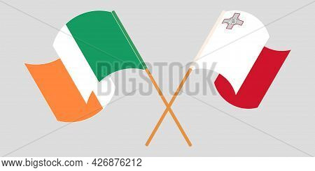 Crossed And Waving Flags Of Malta And Ireland