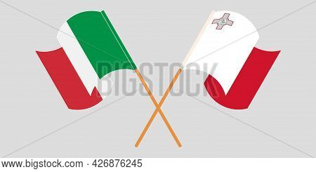 Crossed And Waving Flags Of Malta And Italy