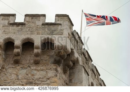 British Flag Is On The Bargate. It Is A Medieval Gatehouse In The City Of Southampton, England. Cons