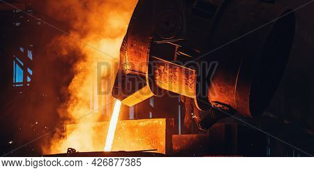 Molten Metal Pouring From Big Ladle. Iron Cast Process.metallurgical Plant. Steel Mill Factory.