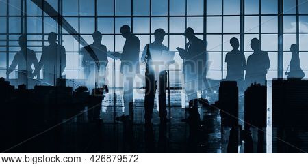 Abstract image of business people silhouette on glass window