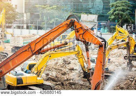 Demolition Crane Dismantling A Building. Jackhammer, Excavator, Cutter Demolishing Old Building.