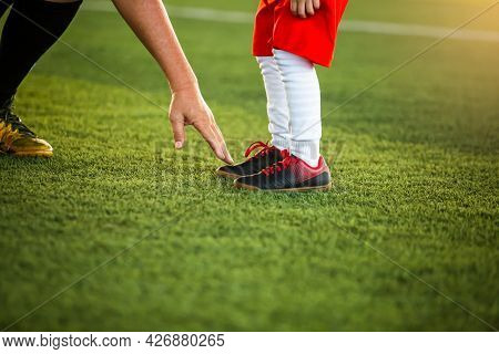 The Coach Is Pointing The Finger At The Feet Of A Kid  Soccer Player