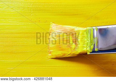 Painting The Wooden Surface Of The Board With A Brush With Synthetic Bristles With Acrylic Yellow Pa