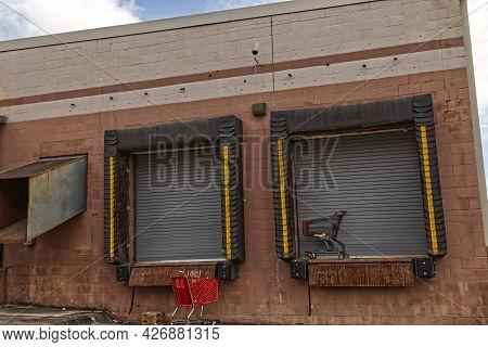 Shopping Carts Abandoned At A Unloading Dock Bay Door