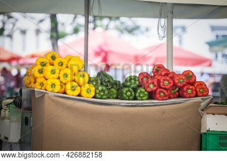Red Green And Yellow Bell Peppers For Sale On A Market Of Slovenia. Peppers Are A Vegetal Typical Fr
