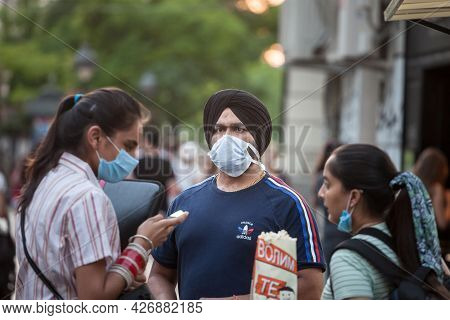 Belgrade, Serbia - July 6, 2021: Indian Tourists, A Sikh Male Man With Its Distinctive Turban From I