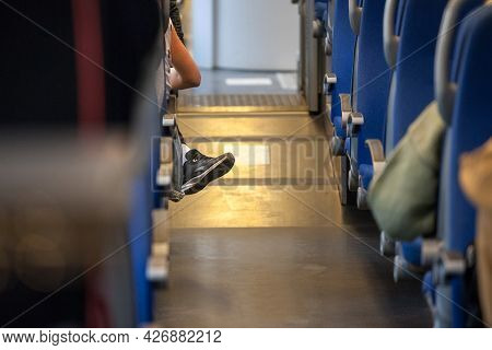 Selective Blur On Seats Of A Passenger Car In A European Train With People Seating On It, With A Sin