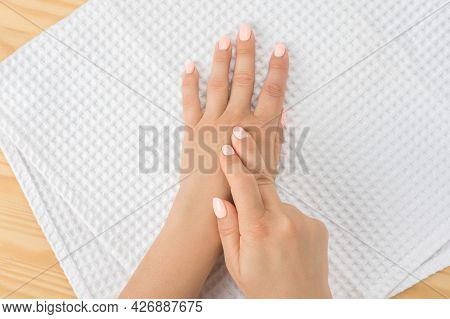 Caucasian Woman With Hand On Her Unhealthy Finger And Palm. Self Massage Office Syndrome And Musclar