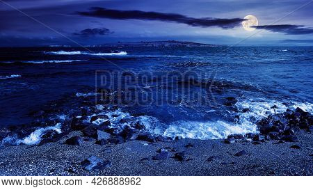 Seascape At Night. Wonderful Scenery With Islands In Full Moon Light. Clouds Above Horizon. Fantasy