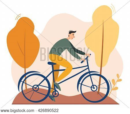 Young Man Riding Bicycle Outdoors In Autumn Park. Environment Friendly, Ecologically Clean Personal