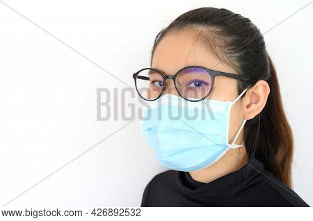 Shot Of Young Asian Woman Worring And Wearing Mask For Protect Bad Air Pollution Or Virus.
