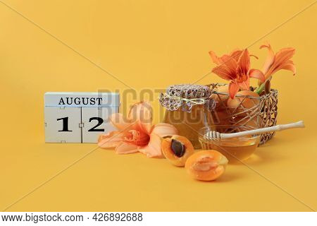 Calendar For August 12 : The Name Of The Month Of August In English, Cubes With The Number 12, Honey