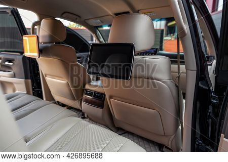 Car Inside. Multimedia Screens Or Tv Displays For Rear Passenger Seats. Luxury Car Interior With Lea