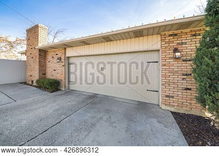 Exterior Of A Side-hinged Garage Door With Concrete Driveway